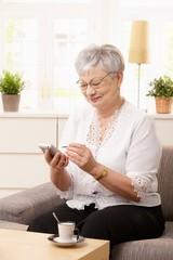 Senior woman using palmtop