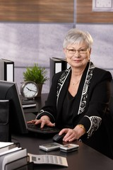 Senior businesswoman sitting in office