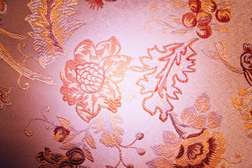 Wonderful flowers embroidered on the canvas.