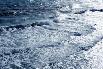 Blue sea ocean waves detail viewed from bird view
