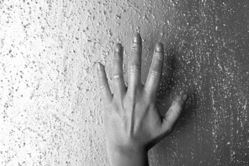 futuristic silver hand over gray texture steel