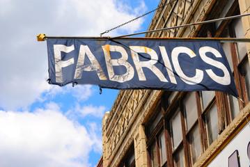 Fabrics Flag above Store