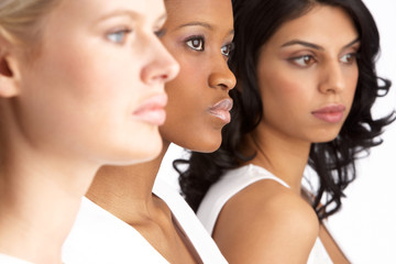 Portrait Of Three Attractive Young Women In Studio Standing In L