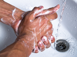 washing soapy hands