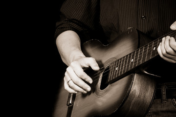 sepia image of man and guitar
