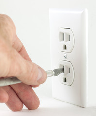 Craft knife in electrical outlet
