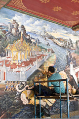 The painter repaint the mural