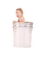 baby in trash can
