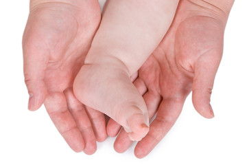 Children foot and adult hand