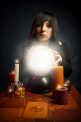 Gothic girl with a crystal ball