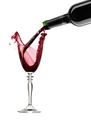 Pouring a glass of red wine with clipping path XXL