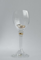 wedding rings in wine-glass