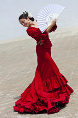 Traditional Woman Spanish Flamenco Dancer In Red Dress With Fan