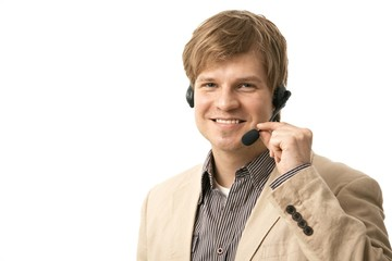 Happy young man talking on headset