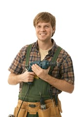 Young handyman with power drill