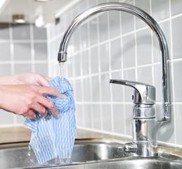 Dish Cloth under running water