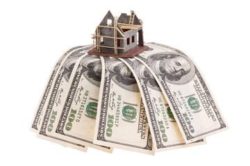 Dollar Geldscheine und Rohbau Haus