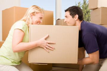Happy couple holding a box