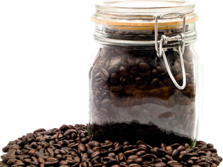 Coffee Beans and a Clear Glass Container with more Coffee