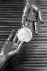 silver euro coins in futuristic robot hands