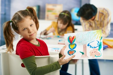 Elementary age children painting in classroom