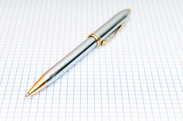 Writing pen on the blank page