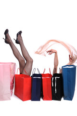 Shopping bags and woman legs