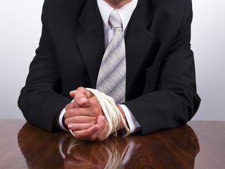 business man tied hands