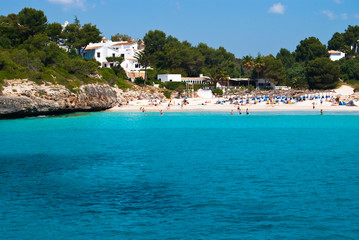 Tursquoise water of Mediterranean Sea at Cala Romantica beach, M