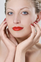 Photo of a beautiful woman with red lips