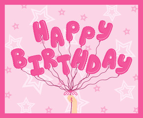 """Hand holding pink """"Happy Birthday"""" balloons on star background"""