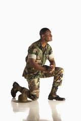 A Military Man Down On One Knee