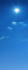 a background image of blue cloudy sky