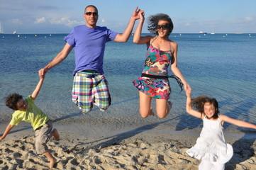 family on the beach - jump on the beach
