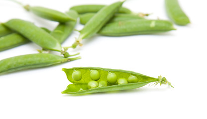 fresh green peapods on white surface; isolated