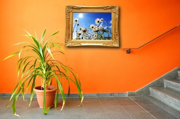 picture on a wall and plant