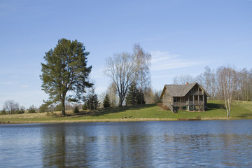 Wooden cottage on the lake shore