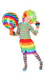 boy in clown dress with multicolored hot-air balloon standing