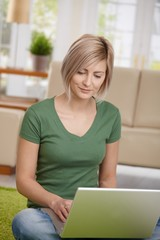 Woman browsing internet on laptop
