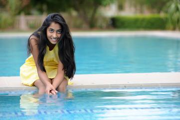 girl sitting at pool