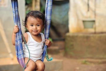 Child on Swings Wall mural