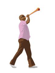 soccer fan blowing a vuvuzela horn