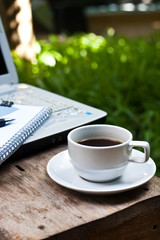 coffee and paper note in garden