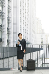 A beautiful Asian businesswoman holding the  documents