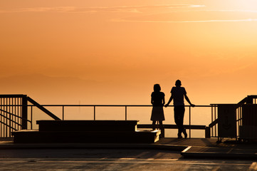 Couple watching the sun set.