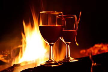 Night romance. Vine against fire.