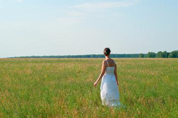 girl against summer field