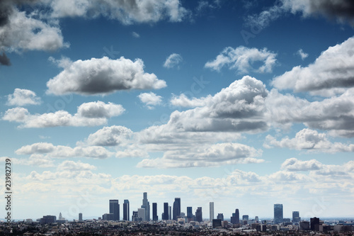Fotobehang Downtown Los Angeles skyline under blue sky with scenic clouds