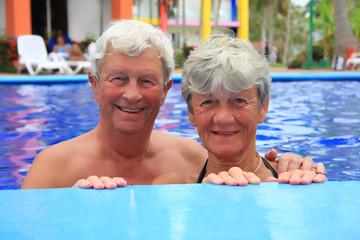 Senior couple in swimming pool.