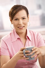 Mid-adult woman drinking coffee